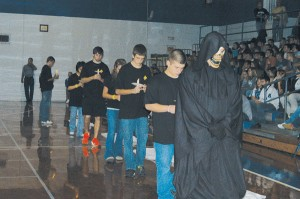 The Grim Reaper leads victims in to the Estill High Gym during Ghost Out last Friday.