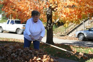 Jane Walters rakes leaves at her home in Ravenna and remembers her husband, the late Buddy Wynn Walters.