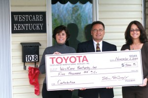 Toyota Motor Manufacturing, Kentucky, Inc. recently made a $5,000 donation to WestCare in Irvine. From left are Estill native Jennifer Noland, Rick Hesterberg of Toyota, and Renee Alexander. Since arriving in Kentucky in 1987, Toyota has donated $34.7 million in sponsorships and contributions to the state's non-profit organizations. Hesterberg said the company likes to give back to the communities where team members reside. Estill is home to 33 employees of the manufacturing facility in Georgetown.