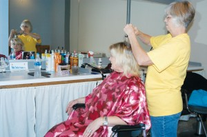 Debra Chaney gets her hair styled by Lavotus at Cuts On Main.