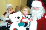 Santa and Mrs. Claus greet children at the Elizabeth Witt Christmas Party