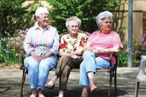 Wilma Calmes, Margueritet Witt and Peggy Powell enjoy the sunshine in the courtyard of the Irvine School Apartments.