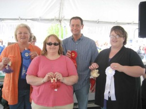 "The 2010 Mountain Mushroom Festival Mushroom Cook-off winners are from left first place, Robin Fassas  for a Fassas family recipe ""Sandollar Ravioli""; second place, Suzi Freeman and Travis Marshall for ""Hot Mushroom Dip""; and third place, Megan Parker for ""Woodland Salad."""