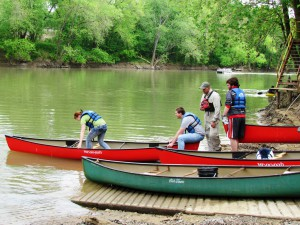 Nathan Depenbrock, from Canoe Kentucky, a canoe rental company based in Frankfort, explains to students the correct technique for boarding a canoe.
