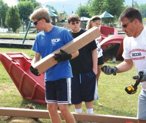 Members of the Canfield Presbyterian youth group assembled playground equipment in Ravenna last week.