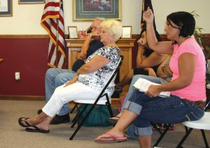 Mickie Delucio, at far right, addressed the Ravenna City Council Monday evening with concerns about the trailer ordinances in the city. Delucio, who lives on Poplar Street in Ravenna, presented the council with a list of names of citizens who support an aspect of the trailer ordinance that deems some homeowners grandfathered and exempts them from other aspects of the ordinance. 