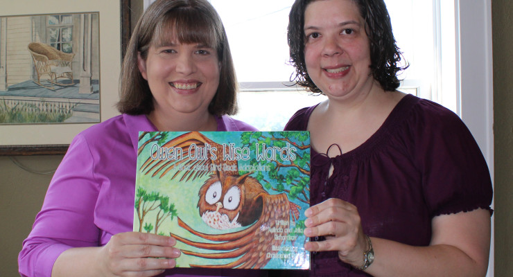 Melinda and Julia Richardson pose with copy of their book, Owen Owl's Wise Words. Photo by KaLeigh Underwood
