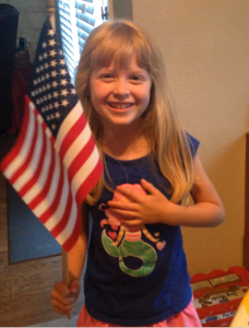 "Five-year-old Emma Long recites the ""Pledge of Allegiance."" Photo submitted"