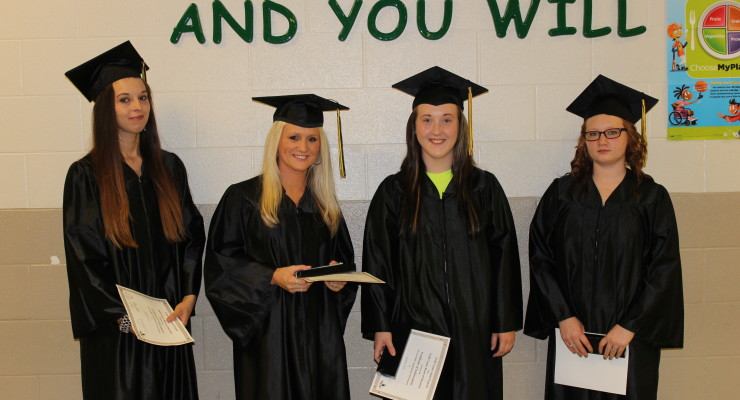 Four graduates participated in a ceremony Friday night when they received their GED diplomas.  Pictured, from left are Angela Peel, Jennifer Payned, Bobie Hall, and Gwendonlyn Cromer. Photo by Lisa Bicknell