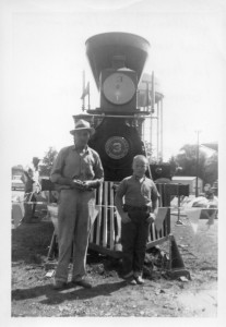Bill Dickerson and his neighbor, Doug Moore (who was about 8 or 9 years old at the time) are standing in front of the General. You can see the Winchester water tower in the background.