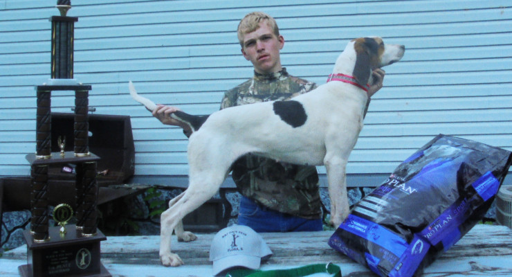 Leonard Young brought home a tall trophy and some other prizes with the help of his hound.  Her name is Jill.