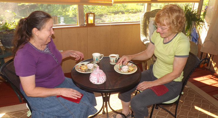 Above, Brenda Luster and Patti Reese share tea time in Patti's summerhouse, built for her by her husband Mark.