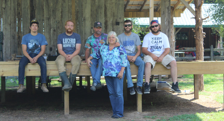 """From left, Craig Burletic, from West Virginia, is one of Tyler Childer's (seated beside him), """"Foodstamps.""""  Tyler and Craig helped build the stage.Byron and Kelli Roberts, center, own the farm on Rosses Creek where the 'Kickin' it on the Creek' festival will be held this weekend.  Clay Case and BrandonToler also helped.  At right, Kenton Roberts and Marion Burroughs also worked many hours on the stage.  worked on the stage almostt every day after work."""