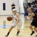 Lady Engineers split results against district opponents
