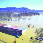 Historic flood damages homes, businesses